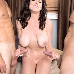 50 plus MILF Karen Kougar jerks off two younger cocks at once