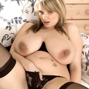 Buxom blonde solo babe Kelly Kay playing with large all natural tits