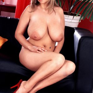 Chesty blonde solo babe Kelly Kay licking own nipples close up