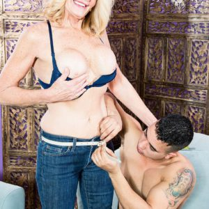 Over 50 cougar Kendall Rex exposing big boobs while stripping off jeans and lingerie
