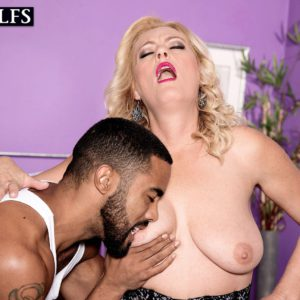 Stocking clad blonde MILF over 50 Lady Dulbin baring big mature tits and booty