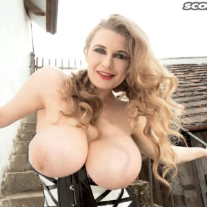 Blonde babe Larissa Linn freeing huge hooters outdoors in high heels