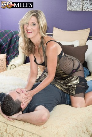 Sexy over 50 mom Lauren De Wynter licking and sucking younger man's cock