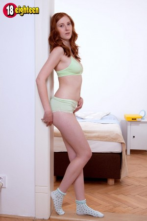 Redheaded 18 year old solo girl Linda Sweet baring tiny tits in socks