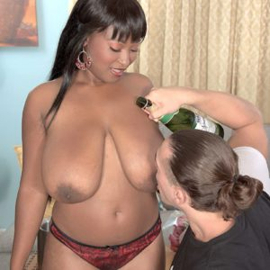 Curvy ebony chick Marie Leone exposing big hanging black boobs