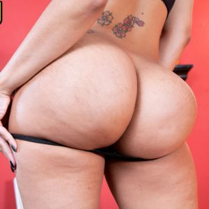 Big butt solo model Mary Jean showing off thong adorned bubble butt