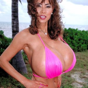 Asian solo babe Minka fondling her massive hooters outdoors