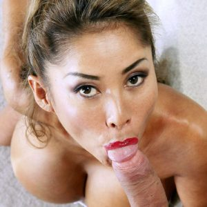 Buxom babe Minka giving large cock ball licking oral sex on knees