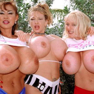 Minka and her chesty girlfriends expose massive melons outdoors in lesbian 3some