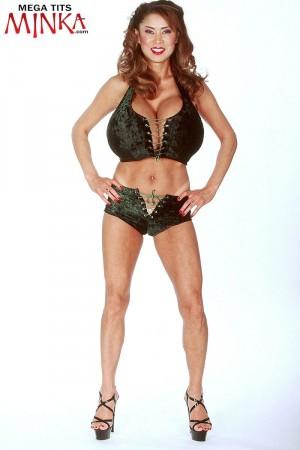 Buxom blonde tit model Minka exposing huge all natural breasts in heels