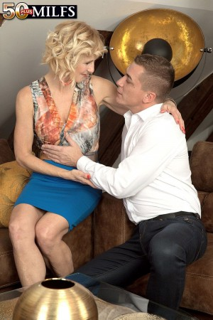 Over 50 blonde MILF Molly Maracas giving CFNM blowjob in short skirt