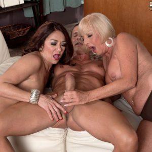 Mature ladies Renee black and Scarlet Andrews jerk and suck cock in threesome
