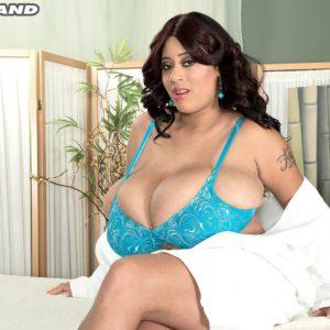Buxom brunette model Roxi Red having huge fun bags fondled