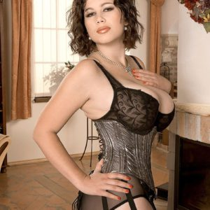 Busty babe Terry Nova striking sexy solo poses in lingerie and nylons