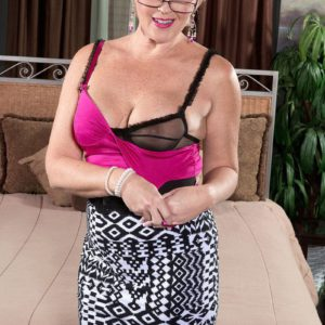 Glasses adorned over 50 MILF Tracy Licks baring mature tits before giving blowjob