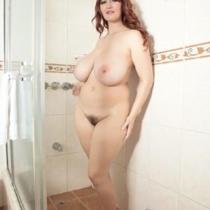 Busty babe Vanessa Y playing with large natural tits in the shower