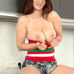 Busty solo girl in denim shorts and boots Vanessa Y plays with nipples in kitchen