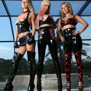 3 marvelous gals in spandex garments and high-heeled shoes debase hooded masculine submissive by pool