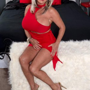 Aged X-rated film star Sally D'Angelo showing off excellent gams and unveiling hefty titties