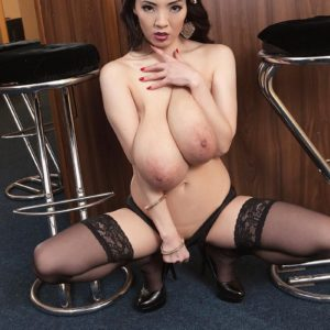 Black-haired Asian stunner Hitomi freeing huge titties in nylons and bloomers
