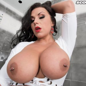 Brown-haired MILF adult film starlet Sheridan Enjoy unveiling brilliant funbags and pierced nips in shower