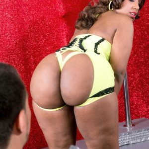 Chunky black stripper Layla Monroe demonstrating enormous ass in ebony heels