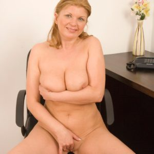 Clothed mature woman loosing enormous tits before spreading wooly cooter in office