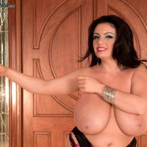 Curvy dark haired MILF Arianna Sinn letting hefty tits loose from melon-holder in pantyhose