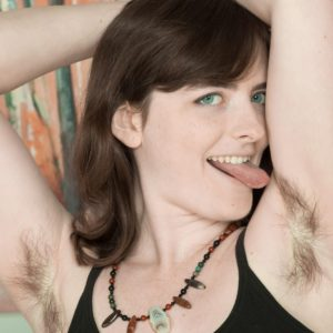 Dark-haired amateur sheds sundress and panties to expose fur covered armpits and cunny