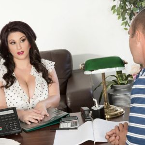 Dark haired BIG SEXY WOMAN pornographic starlet Angel DeLuca having immense funbags unsheathed in office