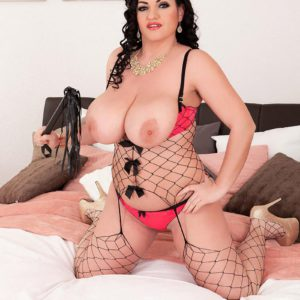 Dark haired solo chick Juliana Simms whipping out big all-natural knockers from lingerie