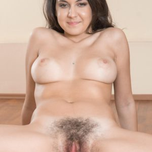 Lithe brown-haired first timer with huge natural titties freeing fur covered snatch under yoga pants