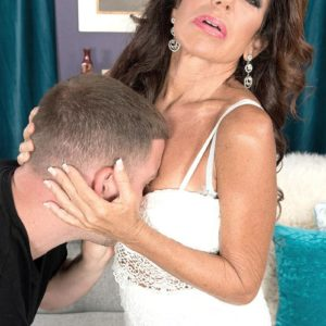 Mature dark haired dame Layla LaMora having lingerie and panties disrobed off