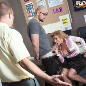 Mature golden-haired lecturer Amanda Verhooks caught providing oral pleasure in microskirt