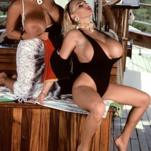Notorious porno star Tawny Peaks and lezzie mistress free gigantic breasts from bikinis on boat