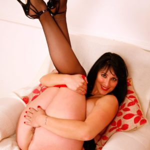 Old dark haired solo model baring big knockers and plus size ass in ebony nylons and heels