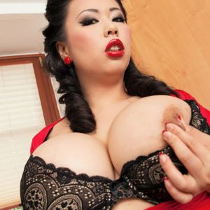 Oriental MILF XXX adult star Tigerr Benson unveiling monster-sized knockers from lingerie in kitchen
