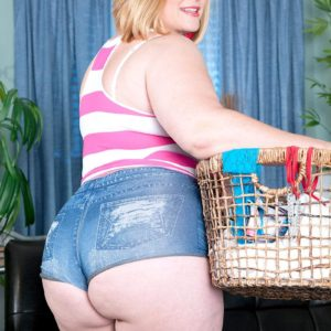 Over weight fair-haired solo chick Marcy Diamond baring enormous butt from denim shorts