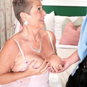 Plump granny Joanne Price uncovering large knockers before giving immense cock fellatio in nylons