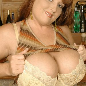 Redhead solo female Brandy Dean loosing humungous fun bags in denim miniskirt and high heeled shoes