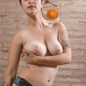 Short haired amateur female Sue unveiling immense natural hooters and hairy fuckbox