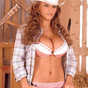Solo chick Ines Cudna letting giant knockers loose in jeans and cowgirl hat in barn