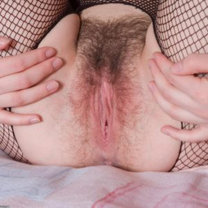 Thin brown-haired first timer displaying furry snatch in crotchless bodystocking