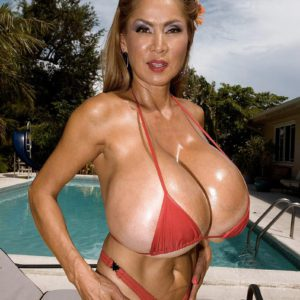Top heavy Japanese stunner Minka oiling massive bikini garbed titties outdoors by pool