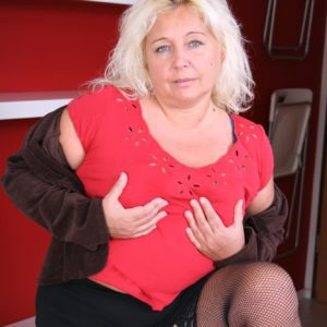 Aged platinum-blonde doll getting rid of mini-skirt and brassiere before slipping bloomers over giant ass