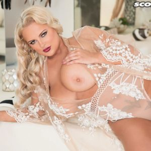 Ash-blonde babe Katie Thornton uncovering huge juggs in see-thru lingerie and pumps