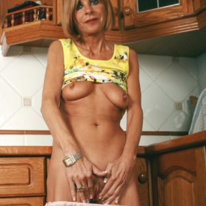 Bony older doll unleashing saggy fun bags and bare ass in kitchen for naked spread