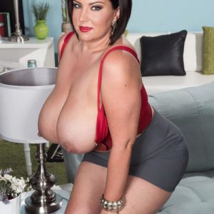 Bootylicious dark-haired MILF Paige Turner letting out humungous all-natural funbags from bra