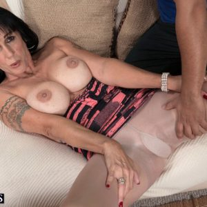 Brown-haired MILF over 50 Moreen Helm exposing hefty titties for junior stud in tights