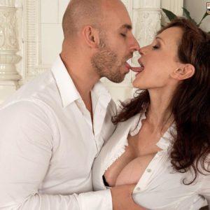 Brunette cougar Michaela O'Brilliant having huge breasts revealed before delivering blow job